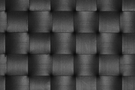 squares background: Stripes of scratched black leather weave pattern abstract squares background.