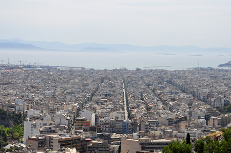 suburbs: ATHENS, GREECE - APRIL 20, 2014: View of the sea and city buildings on the southern suburbs of Athens, Greece.