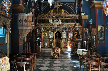 bible altar: ATHENS, GREECE - SEPTEMBER 8, 2013: Greek orthodox church interior. Golden altar with icons and bible stand. Editorial