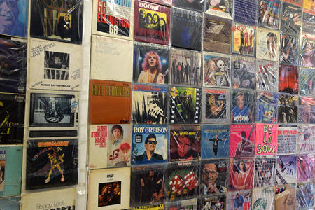 ATHENS, GREECE - APRIL 24, 2015: Old vinyl records vintage pop music lp album sleeves background. Editorial