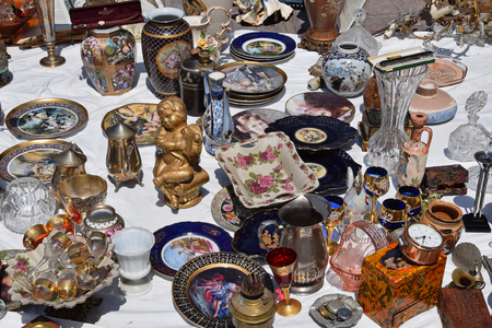 decorative objects: ATHENS, GREECE - MAY 31, 2015: Vintage glass decorative objects antique porcelain plates and vases for sale at flea market.