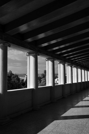 light columns: Light and shadow marble columns abstract architecture. Stoa attalos at the ancient agora of Athens, black and white. Stock Photo
