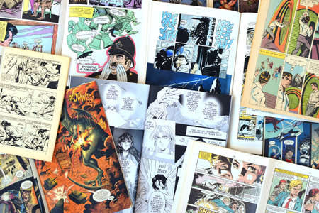 graphic novel: ATHENS, GREECE - MARCH 31, 2016: Vintage comic books and graphic novels. Comics magazines with drawn illustrations abstract background.