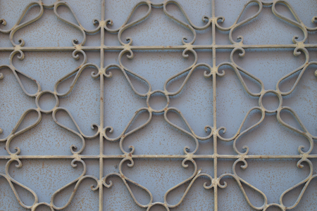 metalwork: Metalwork pattern on weathered rusty gate. Iron texture geometric background. Stock Photo