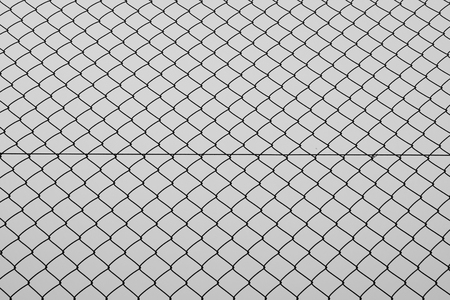 Chain link fencing iron wire mesh silhouette background texture. Abstract pattern black and white. Stock Photo
