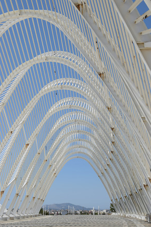ATHENS, GREECE - AUGUST 28, 2017: Arched roof structure designed by famous architect Santiago Calatrava at the Olympic Stadium of Athens. Modern architecture.