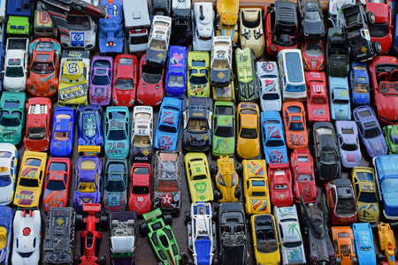 ATHENS, GREECE - SEPTEMBER 14, 2018: Vintage miniature toy cars background. Scale models collection at street market.