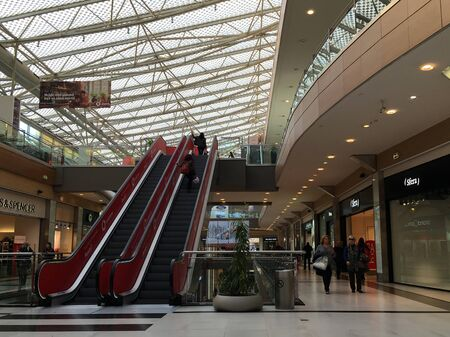 ATHENS, GREECE - JANUARY 17, 2019: Mall shopping centre with people walking and using the escalator. Editorial