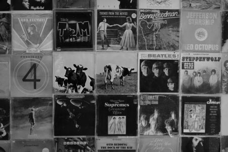 ATHENS, GREECE - AUGUST 29, 2018: Vintage pop rock music vinyl record album cover art displayed at record store. Black and white.