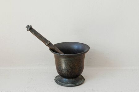 Vintage mortar and pestle. Antique brass kitchenware tool.