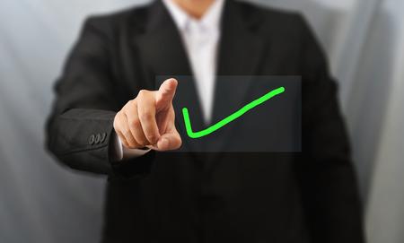 ビジネス人タッチの右の記号 写真素材