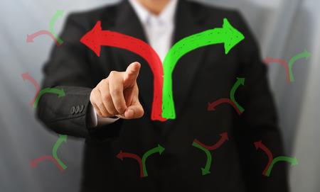 business man touch 2 way sign Standard-Bild