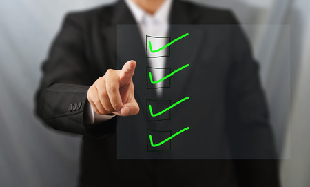 business man touch check list