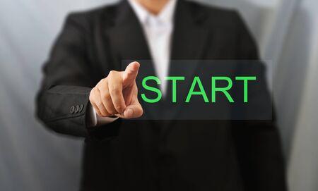 business man touch start Standard-Bild