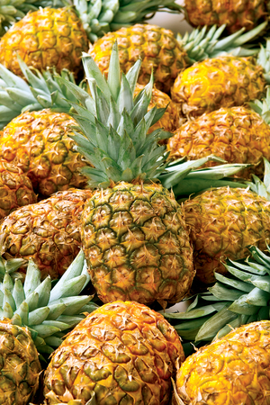 Pineapple sweet tropical fruit juicy raw food on background
