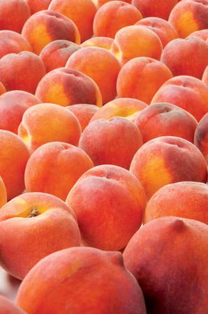 Peaches juicy fruit on backgroud raw food vegetarian
