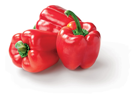 Red pepper on the white background isolated raw vegetable