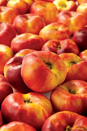 Fresh nectarines on white background juicy fruit Stock Photo