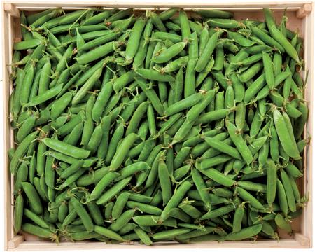 Green peas in a box fresh vegetables raw food