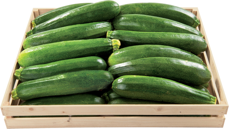 Green zucchini in a box raw vegetable background