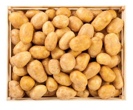 Potatoes in box vegetables food raw background Stock Photo