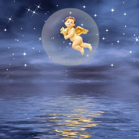 Angel with a star inside a bubble, a night at sea   photo