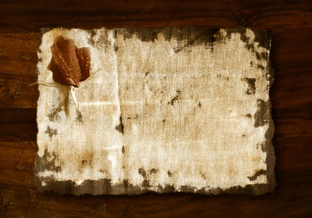 romantic background, rosebud in old fabric on wooden background photo