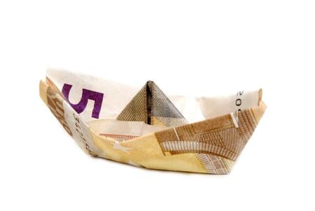 Ship made of money, isolated on white background photo