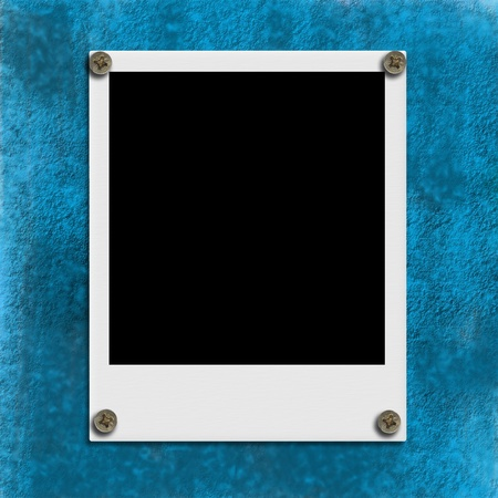 vintage picture frame: Instant empty picture frame hung on the blue wall  Stock Photo