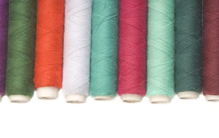spools of thread for sewing colors isolated on white background Stock Photo - 9091099