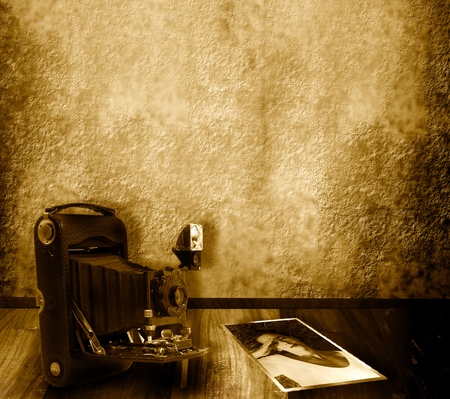 background camera and old photographs of a woman in sepia tone  photo