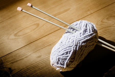 ball of wool and knitting needles on a wooden background in sepia tone Stock Photo - 9275088
