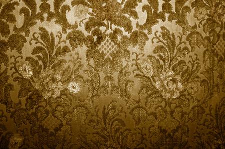 Vecchio tessuto di rivestimento con motivi floreali in tono seppia  Archivio Fotografico - 9324980