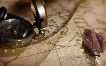 Travel back to ancient compass, map and a rosebud  photo