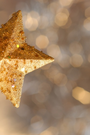 Christmas card, christmas gold star background blur photo