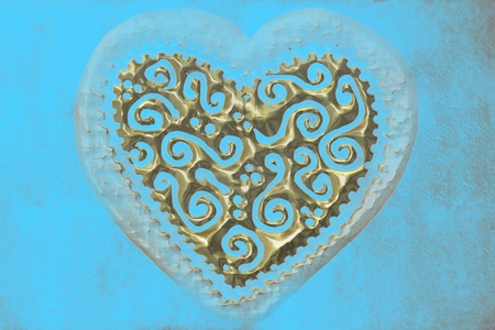 transparent gold heart carved on a blue background photo