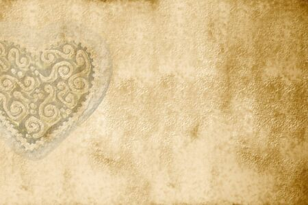 Romantic background with antique heart with copy space photo
