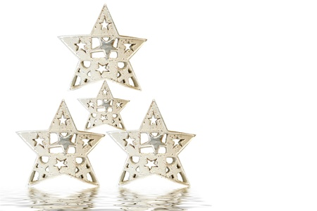 Christmas tree made up of four silver stars on white background photo