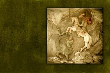 ceramic mural of St. George and the dragon on a green background photo