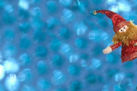 Funny Christmas elf on a blue background out of focus photo