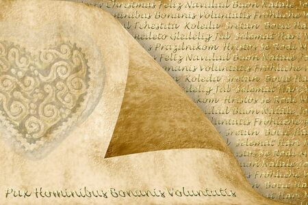 Christmas greeting in several languages, heart and text in gold on sepia photo