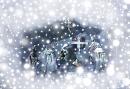 Christmas Card Nativity scene surrounded by stars Stock Photo