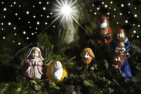 Christmas greeting cards, figurines of the Holy Family and three wise men Stock Photo - 11111870