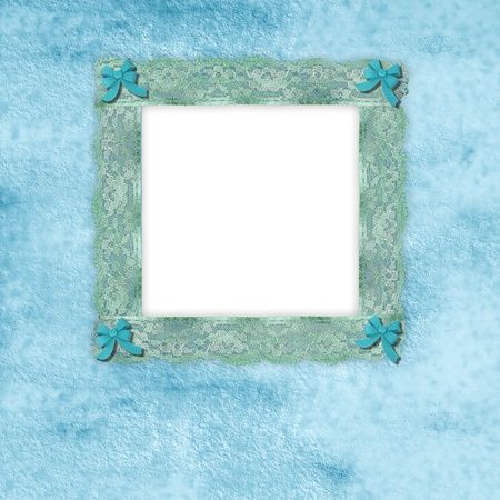 picture frame of old lace with blue ribbons photo