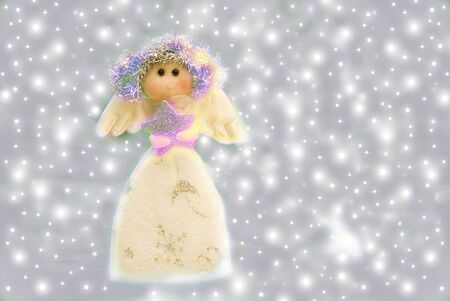 Angel Christmas decorations on a background of stars Stock Photo - 11418893