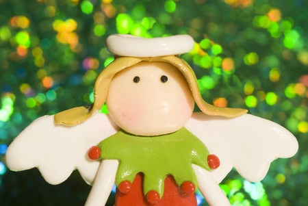 Christmas Angel bright green background blur Stock Photo