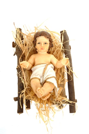 nativity, baby jesus in his crib isolated on white background Stock Photo