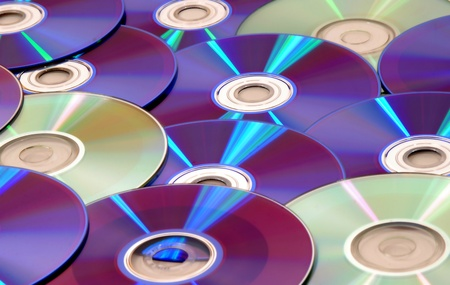 dvds: background full of CDs and DVDs