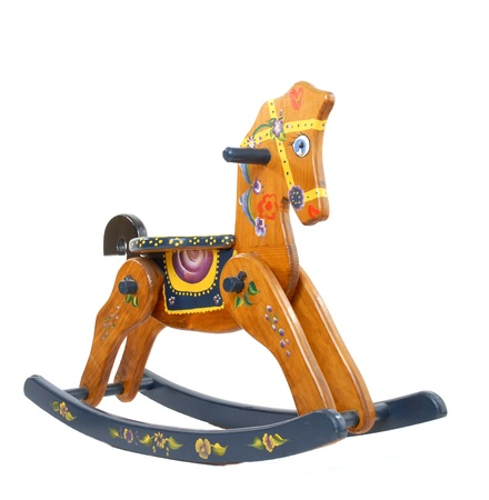 rocking horse isolated on white background photo