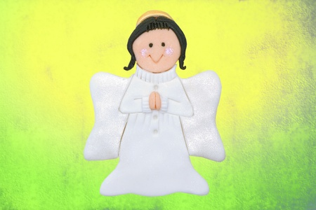 funny angel first communion card of sugar, on colorful background photo